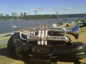"""Mike's Conn Victor 1924 Bb/A """"quick change"""" cornet in front of the George Washington Bridge and Hudson River before a Paragon Ragtime Orchestra recording session."""