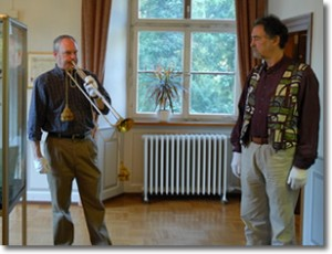 Barry Bauguess trying natural trumpet with Ed Tarr at the Bad Säckingen Musem