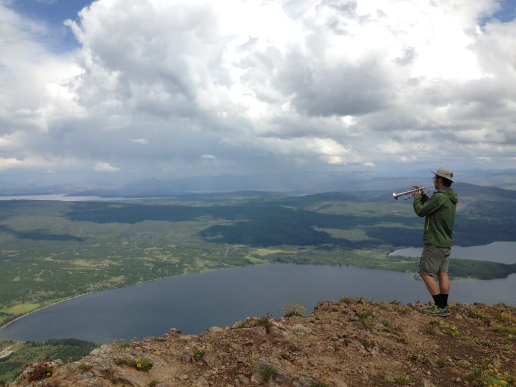 Cheonho playing trumpet from the summit of Mt. Sheridan in Yellowstone National Park