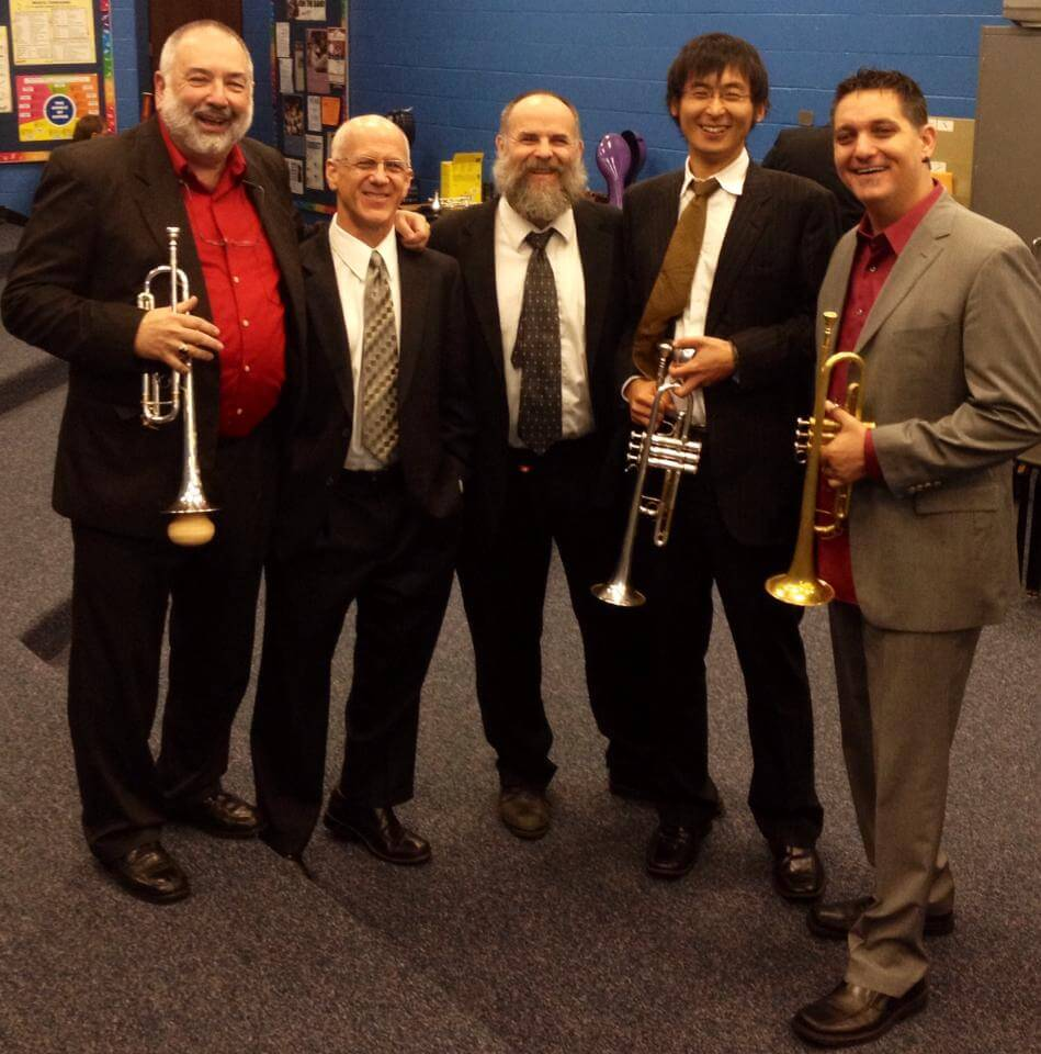 West Virginia Symphony Orchestra trumpet section with guest artists for performance of the Stephan Paulus Concerto for Two Trumpets (l. to r., Vincent DiMartino (soloist), John Schlabach (third trumpet), David Porter (principal), Cheonho Yoon, and Rex Richardson (soloist)