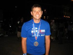Davy DeArmond finishing his first Ironman triathlon